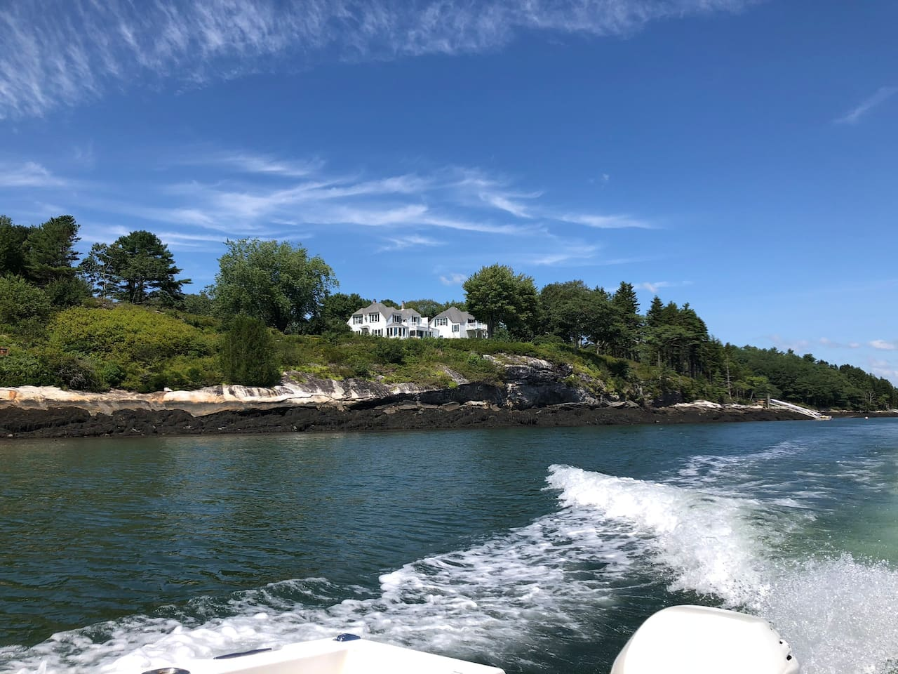 The Cottage sits on 3.5 acres of privacy,...with its own peninsula overlooking a small and active cove.  A shoreline path takes you in front of the cottage to a dock with a seating area onshore and a Mooring in the cove for your boat.