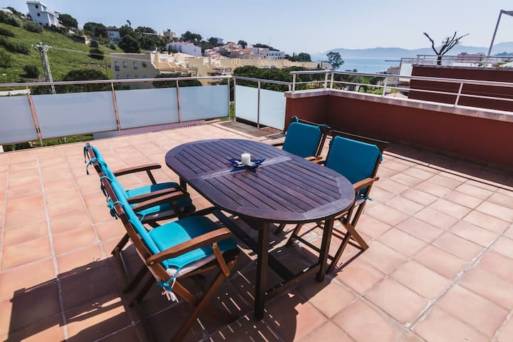 Charming penthouse in the grifeu area with large terrace overlooking the sea