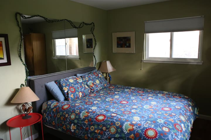 Queen bed, windows to patio and front yard, large closet that has hangers plus iron & ironing board.