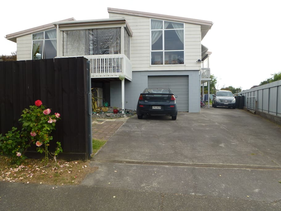 Front entrance of house with plenty of secure off street parking on property..