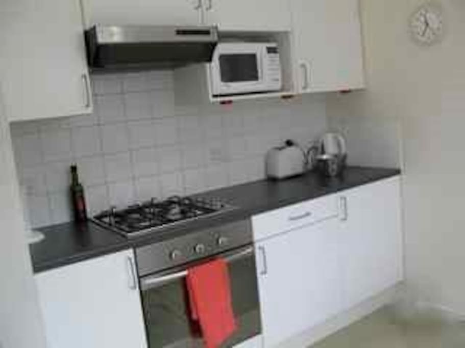 Galley Kitchen gas stove electric oven microwave kettle toaster