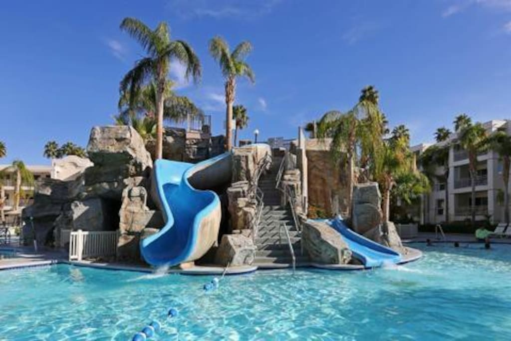 Large slide, and small slide in the shallow kiddie pool area