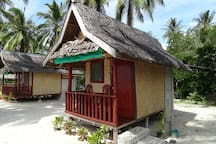 Both bungalows are made of wood and bamboo. Only the bathroom is concrete and tiled