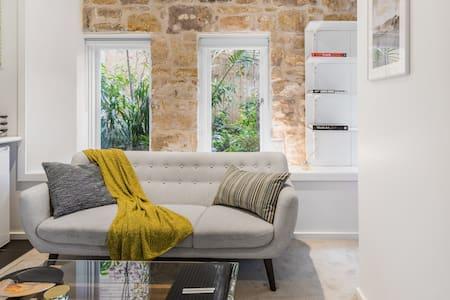 Lavish Suite with Stone Archway Patio