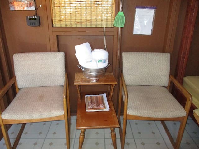 2 chairs and small table inside each bunkhouse.