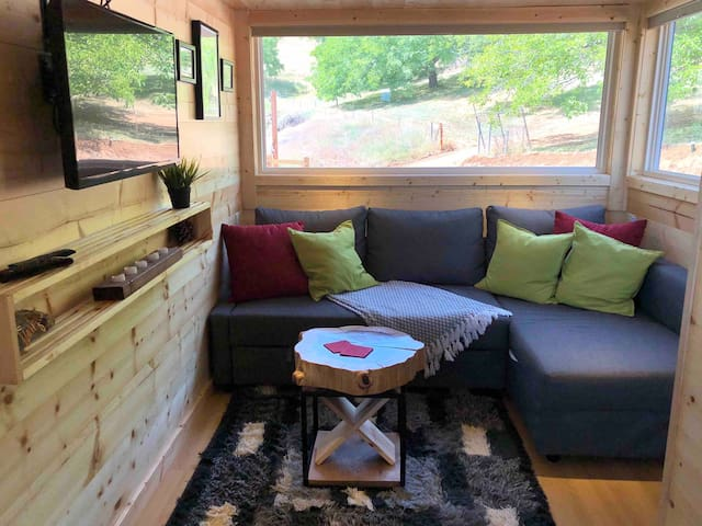 A comfortable living area with a TV connected to a Roku Unit for all your streaming needs!