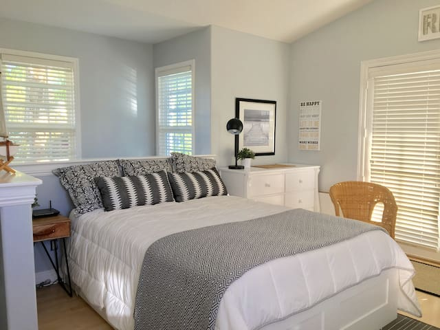 comfy queen bed with fresh new linens