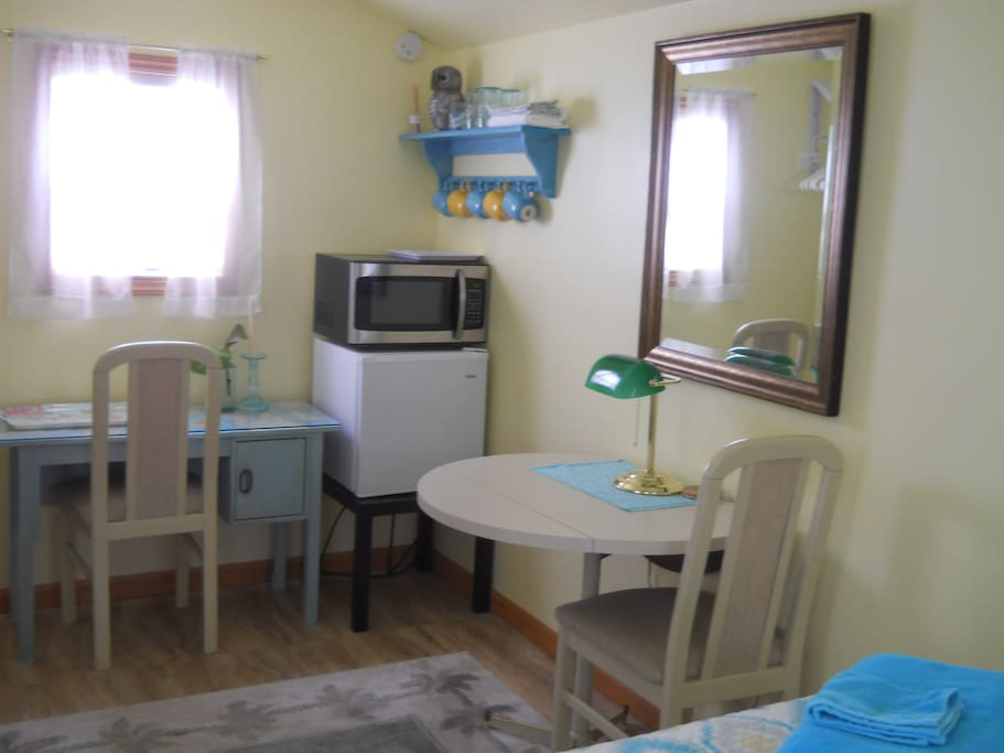 Mini fridge, microwave oven, table, desk, two chairs