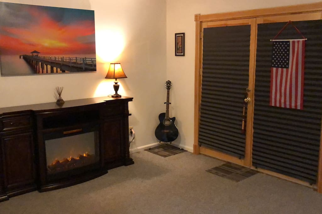 Lower Level Studio Apartment.  Private entrance.  Electric fire place and canvas art work are displayed.  Total Privacy.