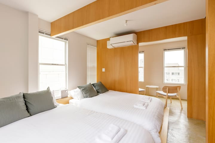 Inside the bedroom are two double beds, so 4 people can share the room. The air-conditioning unit is here to provide you with a good night's rest.