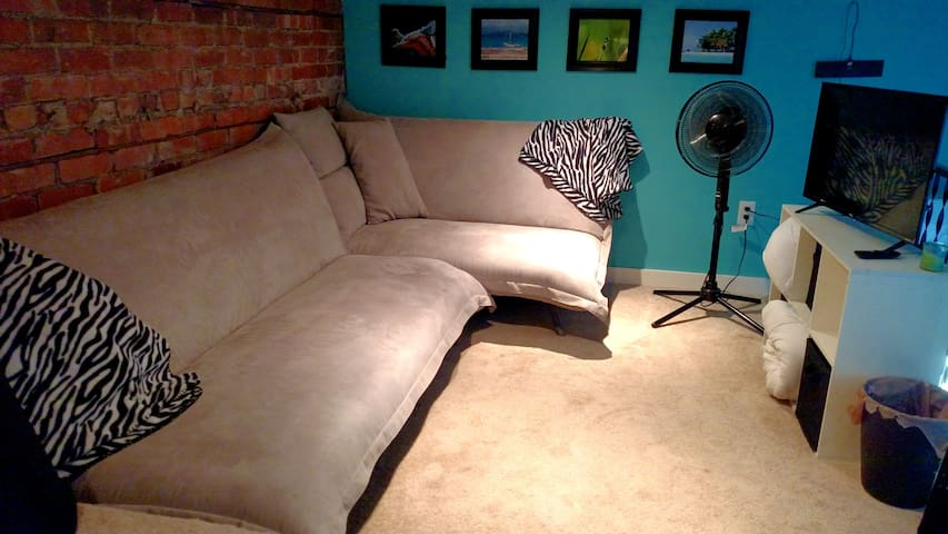 The loft seating area has a smart TV and also the futon can be converted into a full sized bed.  Please let us know if you'd like it made up into a bed when you make your reservations.  * loft area is a comfortable place to and watch tv, however please note that it is a low-ceiling area.