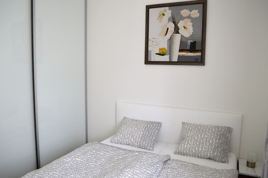 Bedroom with wardrobe and bed