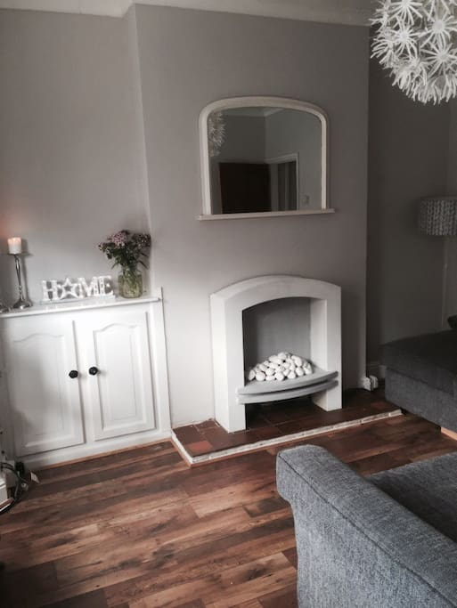 Cosy living room with large corner sofa and Widescreen TV