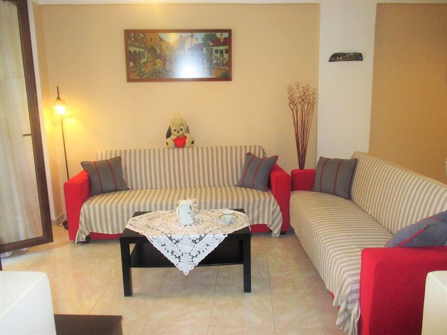 The living room with two comfortable   sofas that can easily turn to beds.