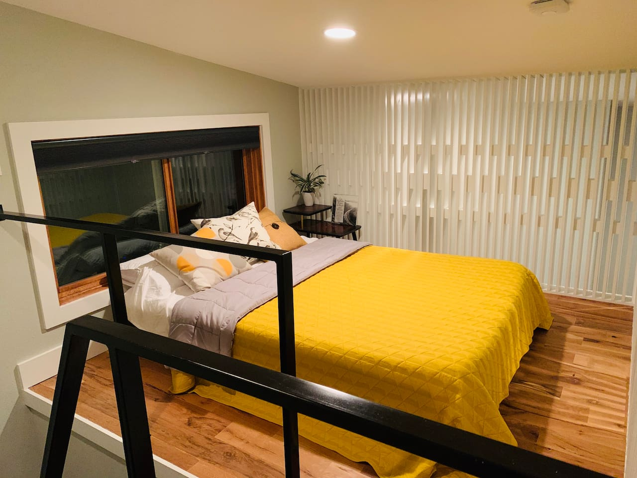"""Birdhouse loft """"The Birdnest"""" is just completed and provides a cozy nook with a queen memory foam mattress and black out blinds on the screened window for a comfortable nights sleep."""