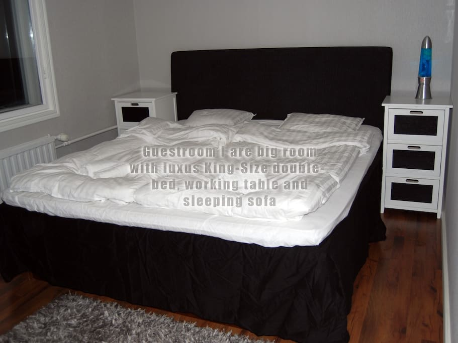 Guestroom I are big room with luxus King-size double bed, working table and sleeping sofa