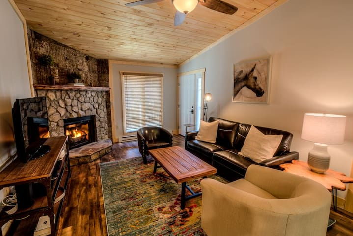 Warm and inviting Great room with fireplace and all new furnishings! The leather sofa has a full size memory foam mattress for additional sleeping.  Come and enjoy!