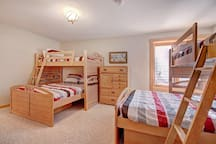 Lower level bunk room with 2 twin over full bunk beds.