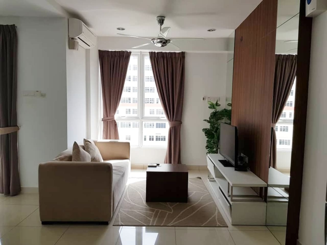LIVING ROOM is furnished with a cosy 3-seater sofa set, a table, a TV and a cabinet. Sufficient natural light brightens  up the room during day time. For comfort, the place can be  air-conditioned. To some, ceiling fan is a good enough option.