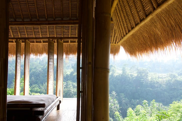 From veranda looking into a bedroom and the view to the gorge beyond.