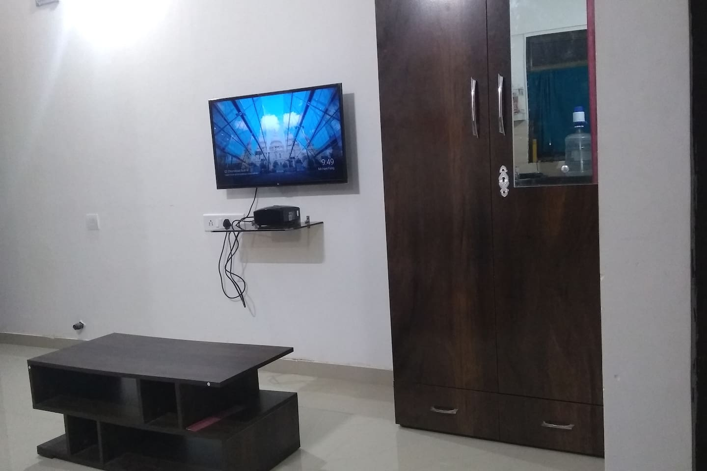 Smart TV with coffee table in Hall