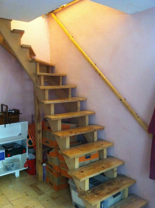 stairway from main bedroom to kitchen