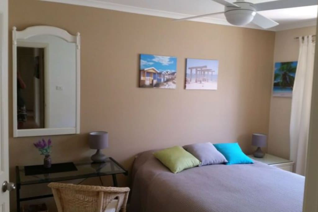 Comfortable Queen size bed. Built-in wardrobe hanging space. Ceiling fan +free Wifi