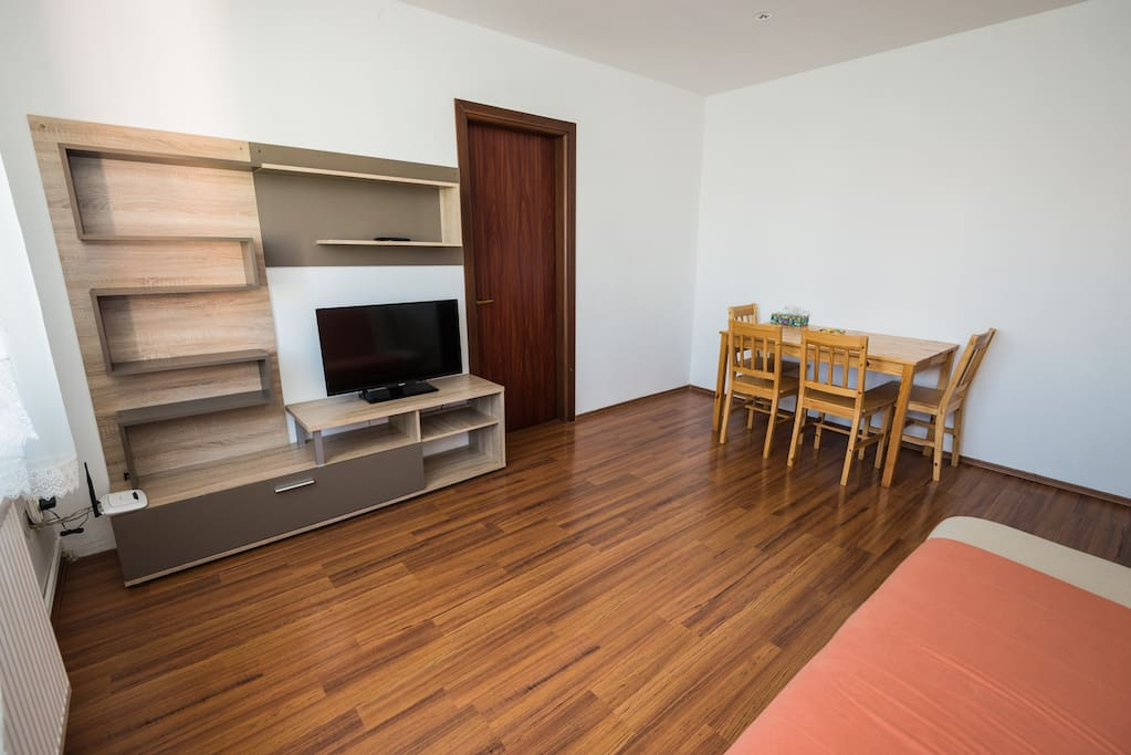 The living room has a comfy extendable couch, a four seat table and a flat screen TV. Free WiFi available.