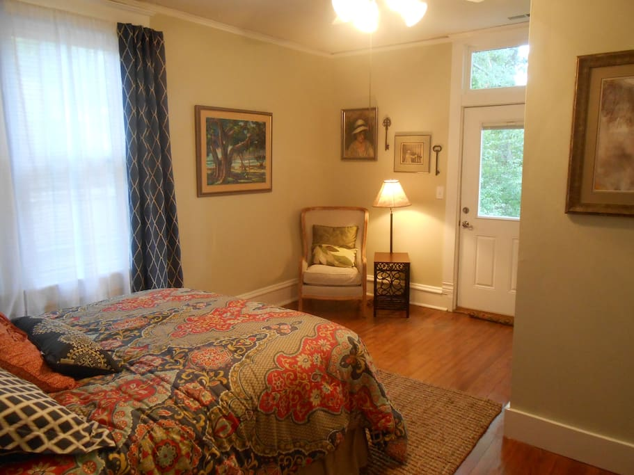 Bedroom with queen bed and small sitting area