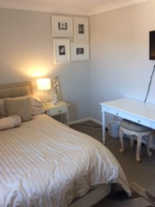 Always fresh looking room with a comfy Queen Bed, working table, TV, built-in wardrobe.