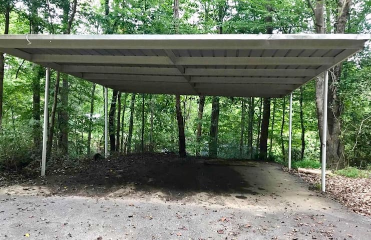 Guests have their own covered carport parking area.