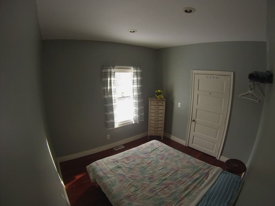 Private room with dresser and closet space. Towels provided within the room.