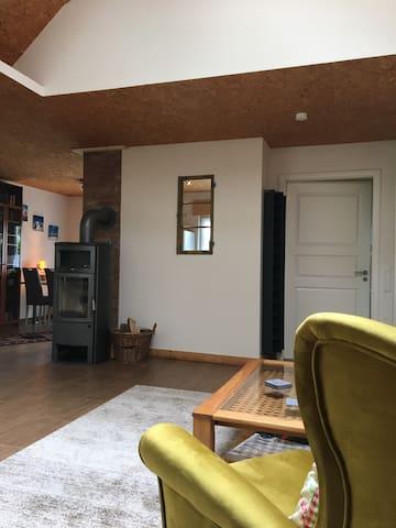Wohnzimmer mit Blick auf den Hark Kaminofen