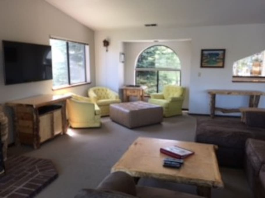 Spacious Living room, W/Plasma cable TV, wood stove fireplace, stunning views, and plenty of seating