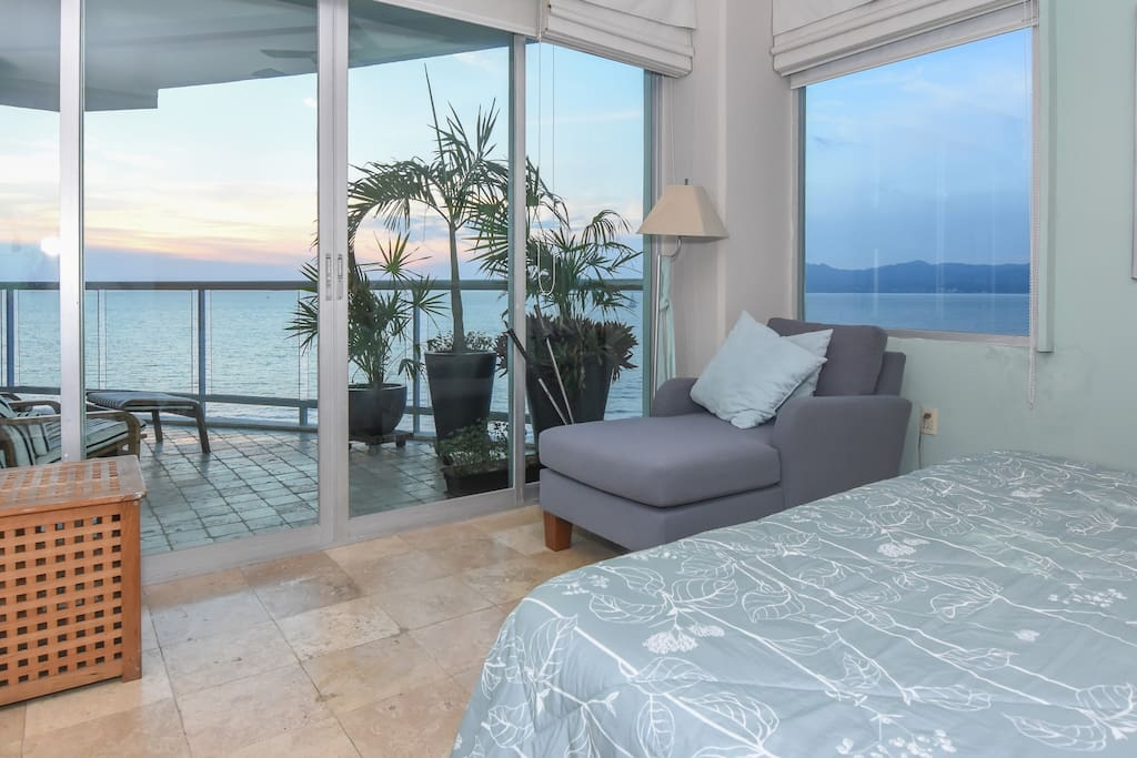 The Master Bedroom has a full view of the bay
