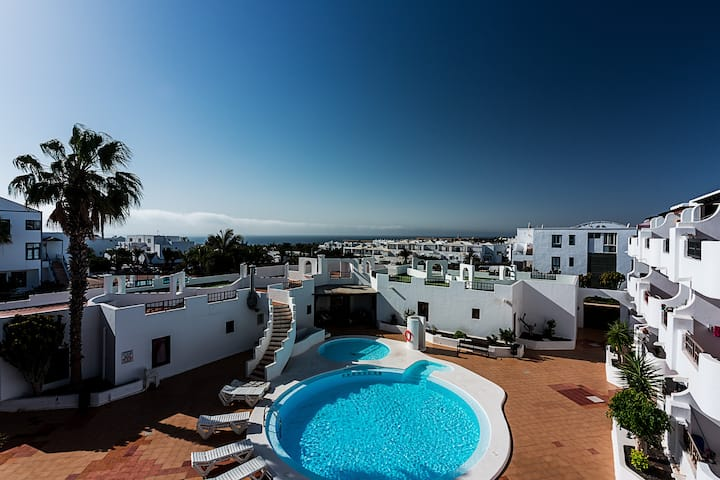 Golden Sun apt in complex w/pool Costa Teguise