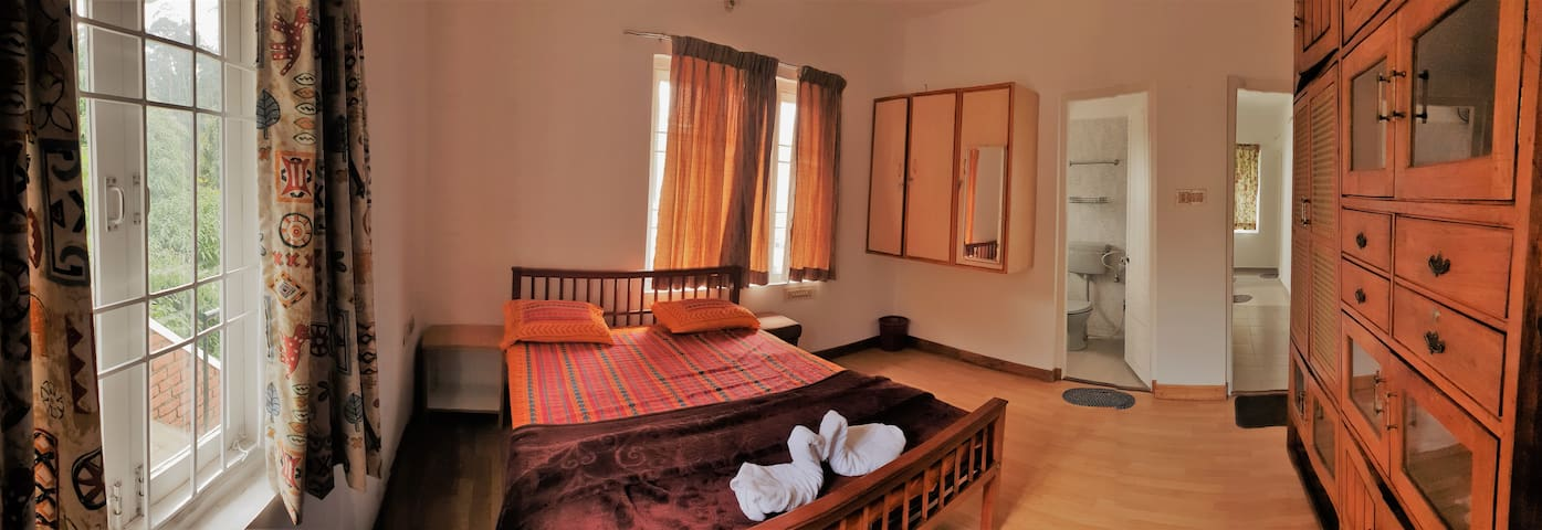 GUEST BEDROOM 1:Panoramic view of the room, with inbuilt wardrobe and attached toilet