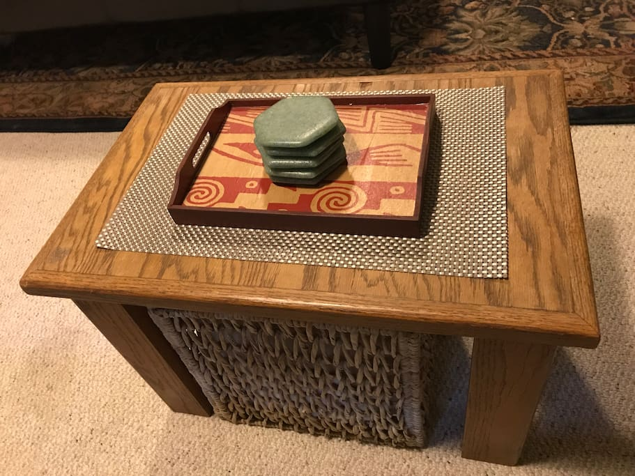 coffee table with stored blanket underneath