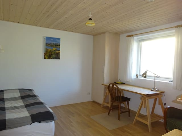 A: Large room near a sandy beach - free parking
