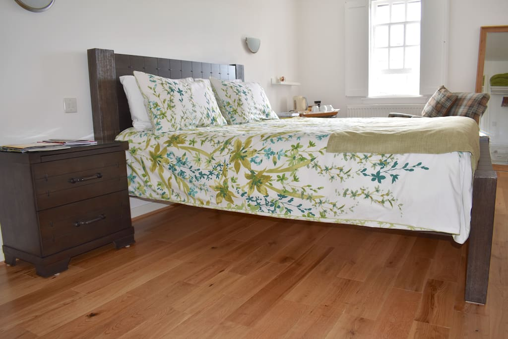 Value - new Queen size bed made of rubber wood, 30cm deep mattress purchased July 2017 and oak flooring.