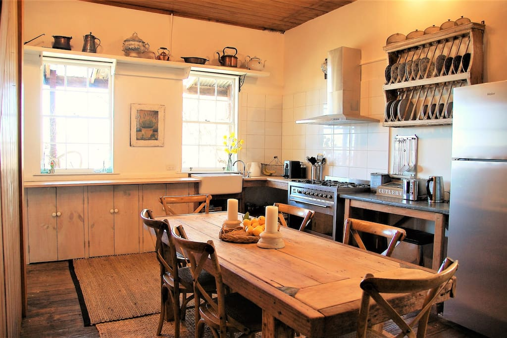 Well stocked country kitchen with entertainer's oven, combustion fireplace and valley views.