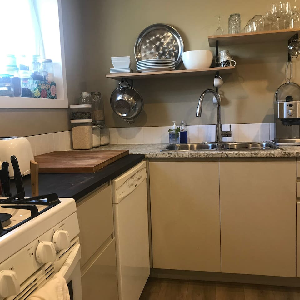 Well equipped kitchen with many quality small appliances, gas stove, 2 fridges, microwave, dishwasher, washer/dryer, dishes, quality pots/pans/knives, and numerous spices.