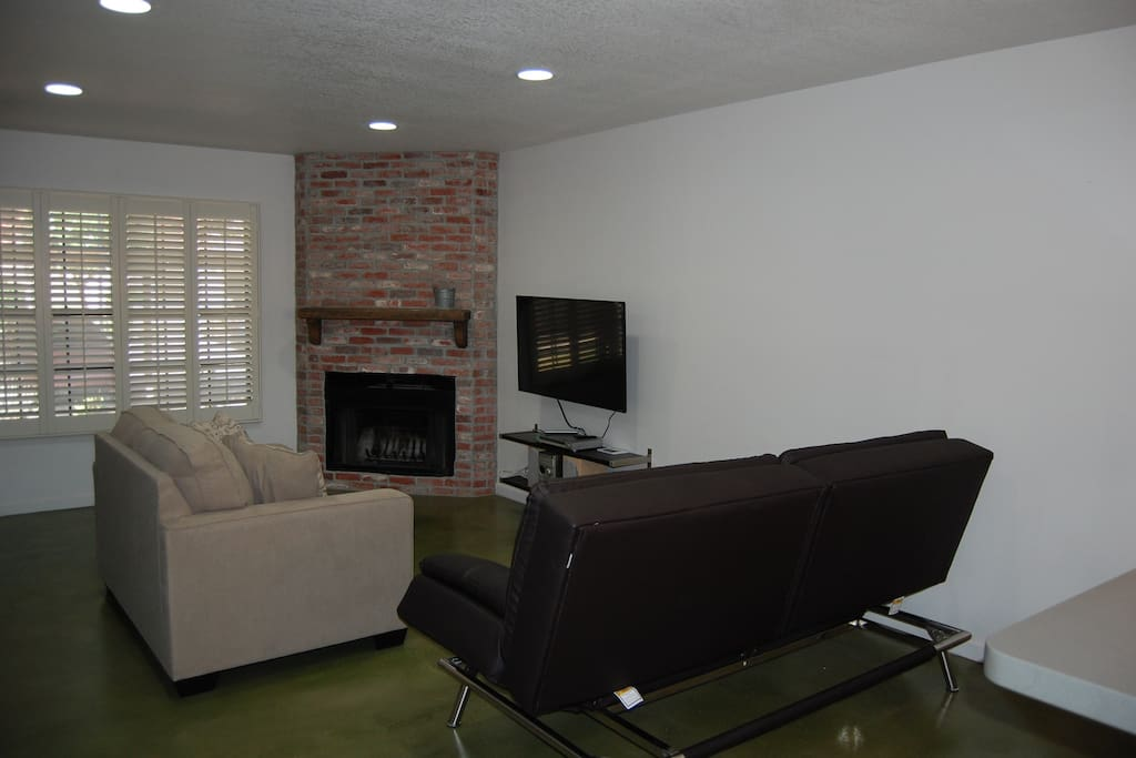 "Living room with fireplace and 48"" tv"