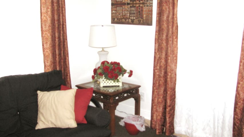 Enjoy a quiet moment or two, watching TV or reading in a well lit area that speaks of comfy surroundings.