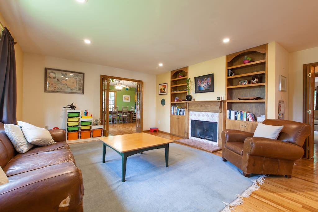 Living Room has comfy furniture and lots of light.  Gas fireplace and toys for kiddos.