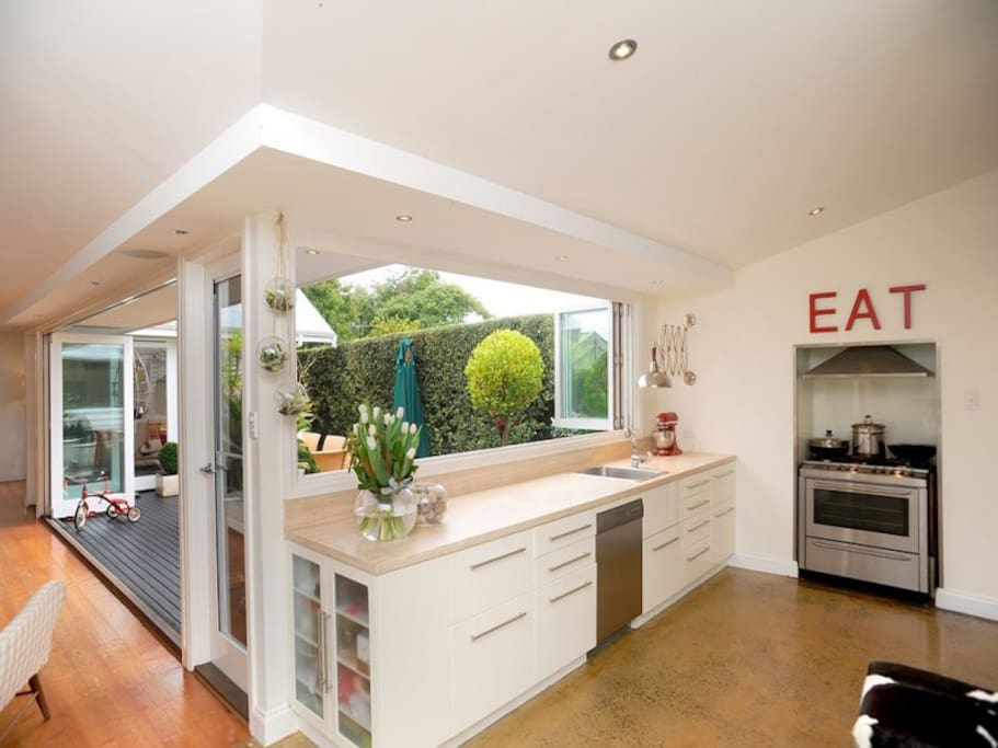 Hosts will enjoy the ease the kitchen design brings to catering, particularly the step-in appliance store, pull-out pantry and servery windows to the deck.