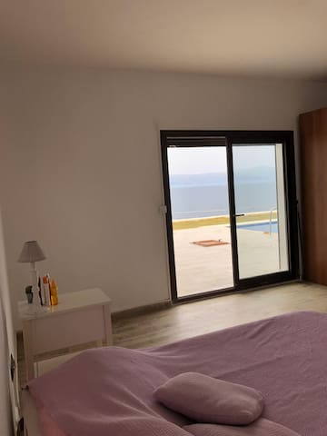 Bedroom 1  in first floor, opens to swimming pool directly.