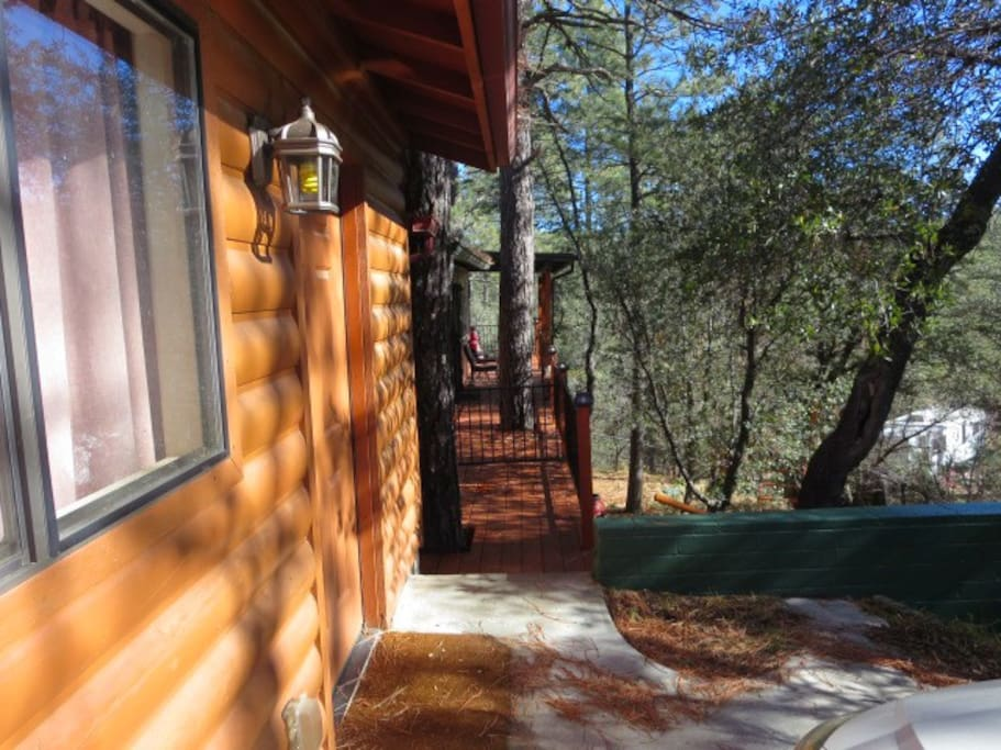 Come onto the deck to look out on the trees and mountains