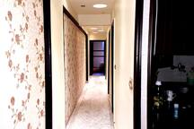 * Long passage To all Rooms   * many levels of lighting  * 3D Wallpaper   * Wood Decoration  * Long White Modern Carpet