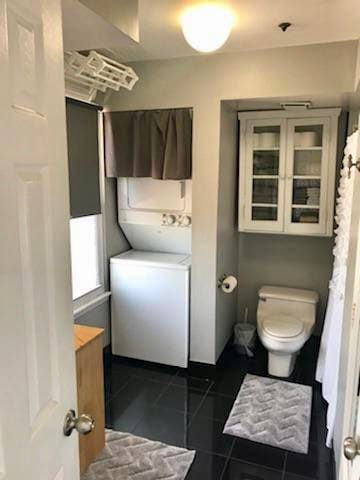 Spacious Bathroom with washer/dryer. The bathroom is off the master, there are also vanities in each bedroom to assist with getting ready for a big night out!